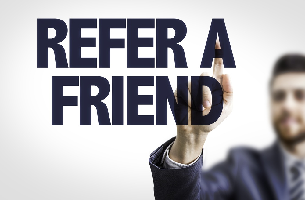 Referral traffic shown by a business man pointing the text Refer a Friend