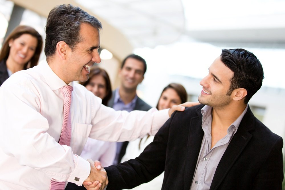 Marketing agency partners closing deal with a handshake