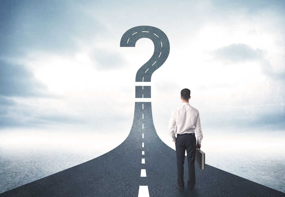 Question and answers. Business person looking at road with question mark sign concept