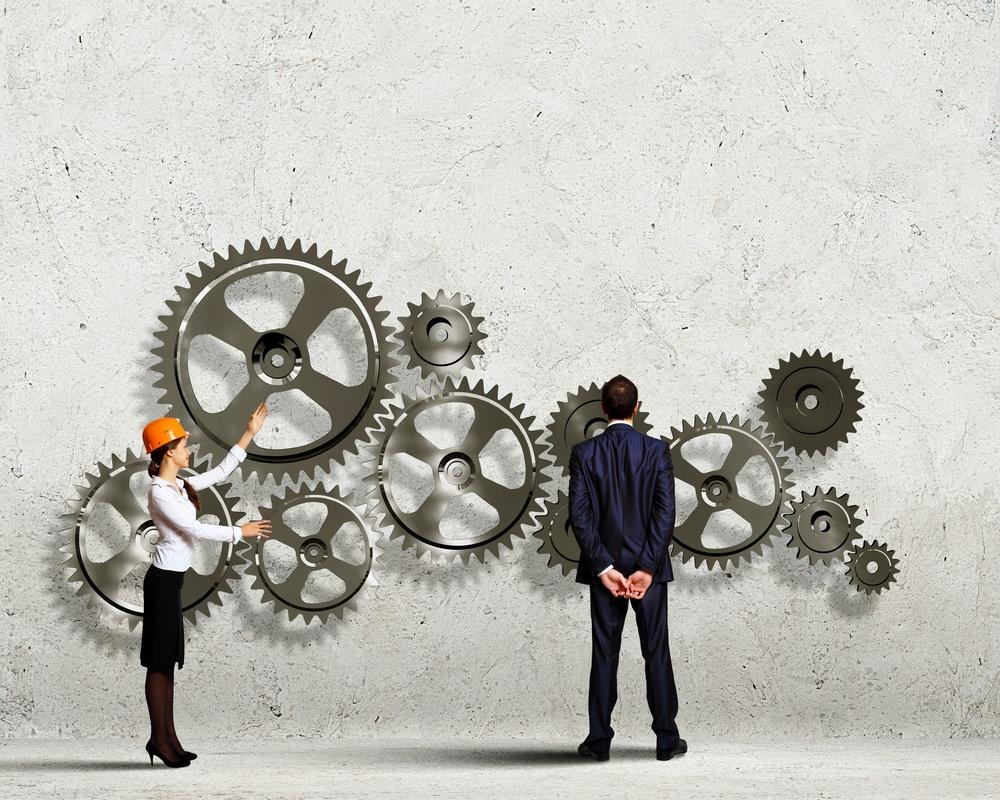 Businessman and businesswoman with cog wheel elements. Organization concept.jpeg