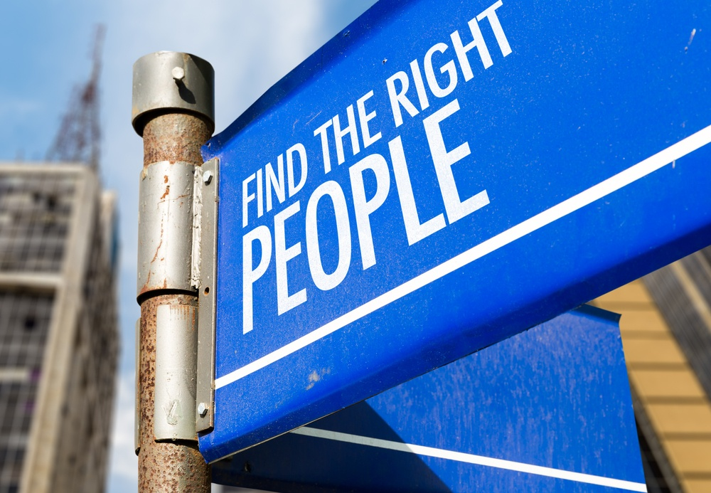 PPC agency team - Find The Right People written on road sign