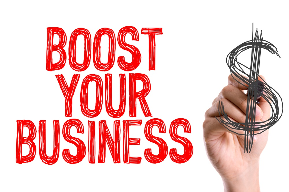 Hand with marker writing Boost Your Business with PPC