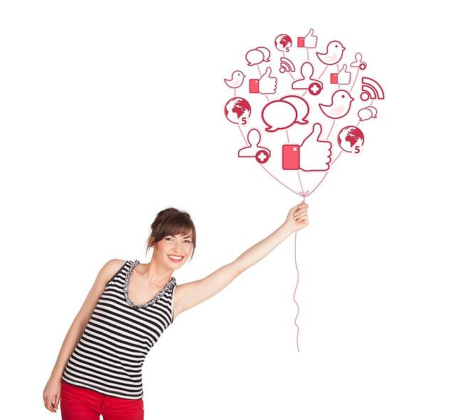 Social traffic shown by a happy young lady holding social icon balloon