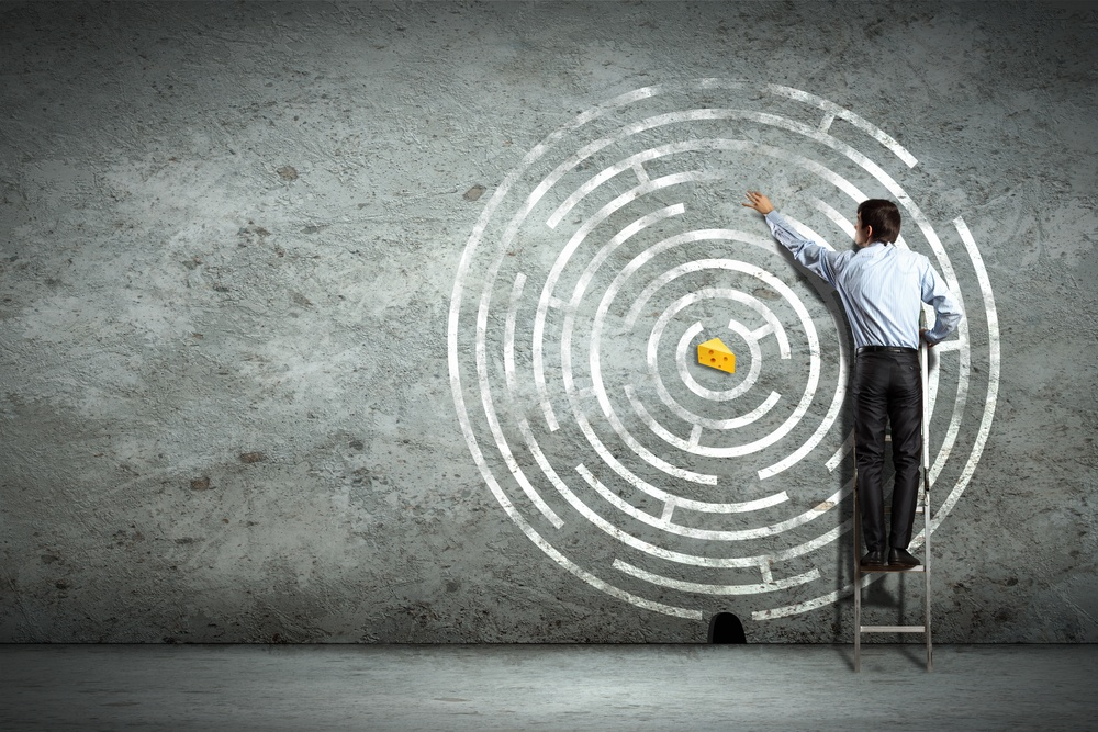 PPC complexity: Image of businessman standing on ladder against maze picture