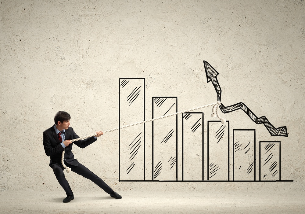 Image of young businessman pulling graph. Chart growth concept