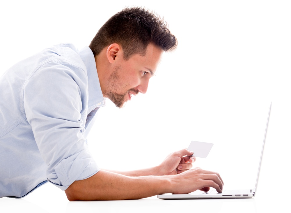 Man shopping online for a dentist