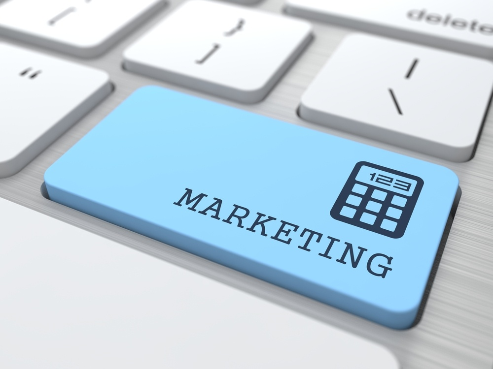 Marketing Concept. Marketing Word on Blue Computer Button..jpeg