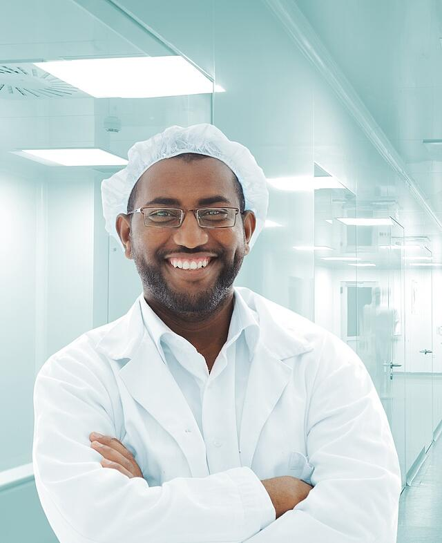 Portrait of African doctor in modern hospital.jpeg
