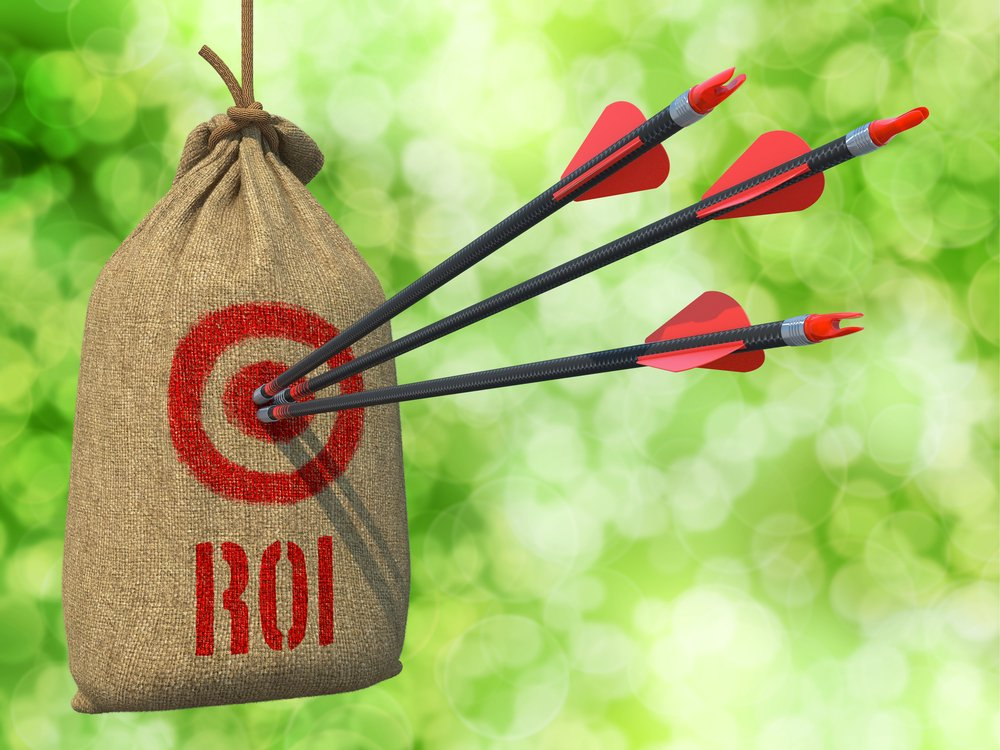 ROI from a digital marketing agency - Three Arrows Hit in Red Target on a Hanging Sack on Natural Bokeh Background.