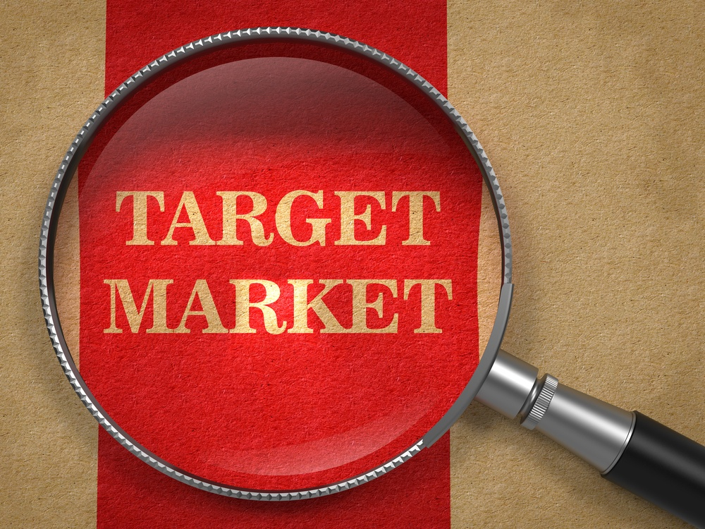 PPC Target Market - Magnifying Glass on Old Paper with Red Vertical Line.-1