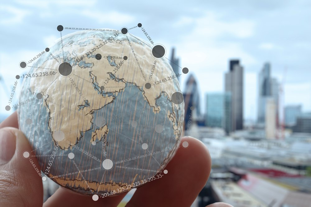Let Google and Facebook optimise. Close up of businessman hand showing texture the world with digital social media network diagram concept Elements of this image furnished by NASA London city background