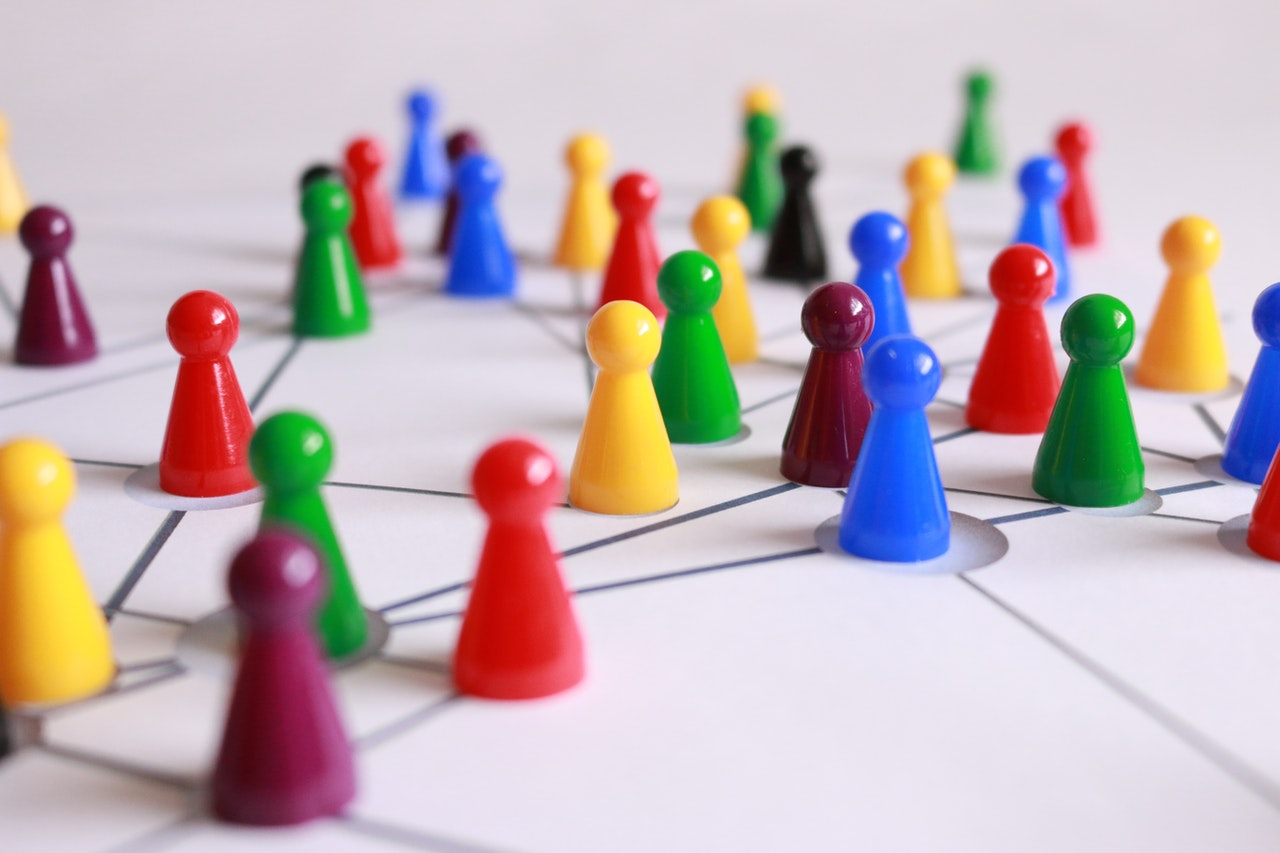 Strong Leadership will prevail. Colourful game pieces grouped