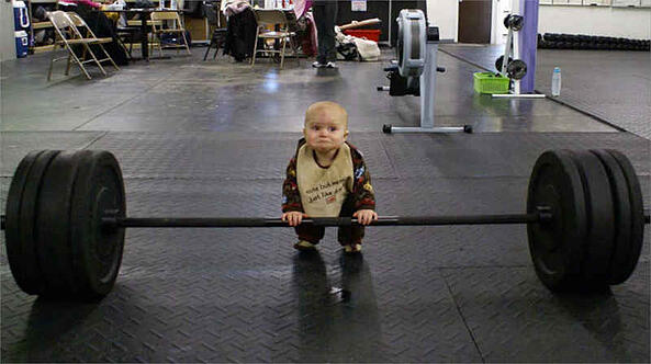 baby lifting large weight