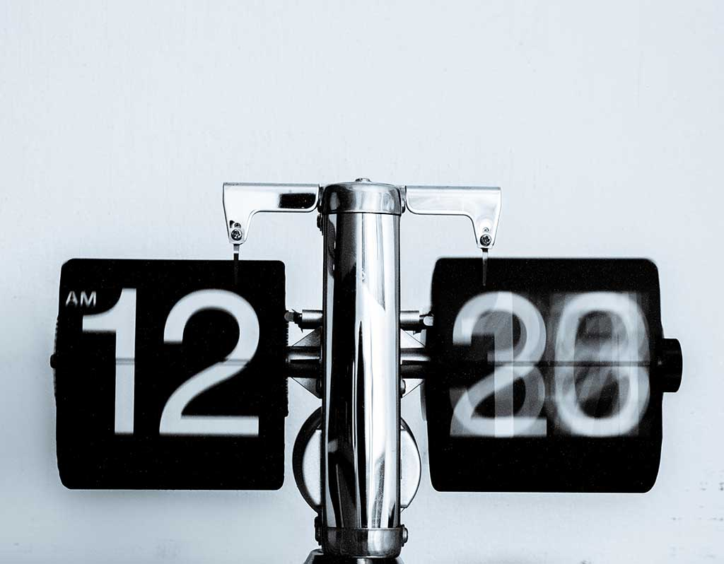Vintage clock showing time to publish online content