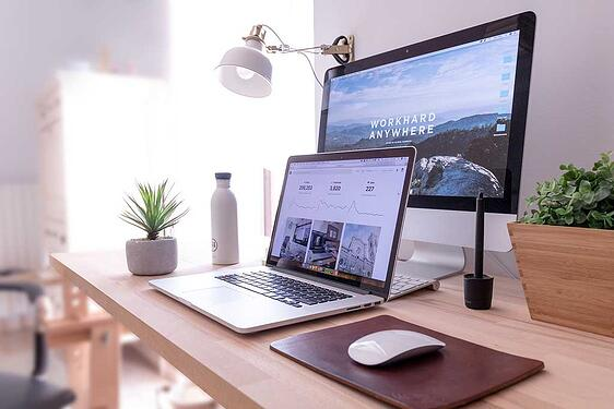 two computer on a desk; seo and website