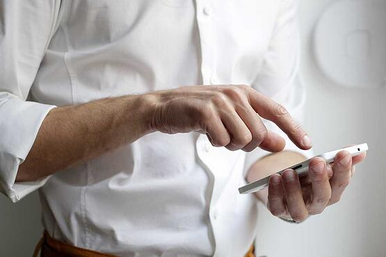 man using his smartphone white